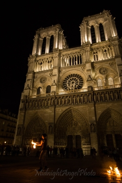 Fire Dancers in front of the The Notre-Dame Cathedral