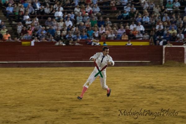 A matador charges the bull during the Tercio de Banderillas