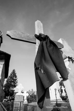 An old scarf upon a wooden cross...